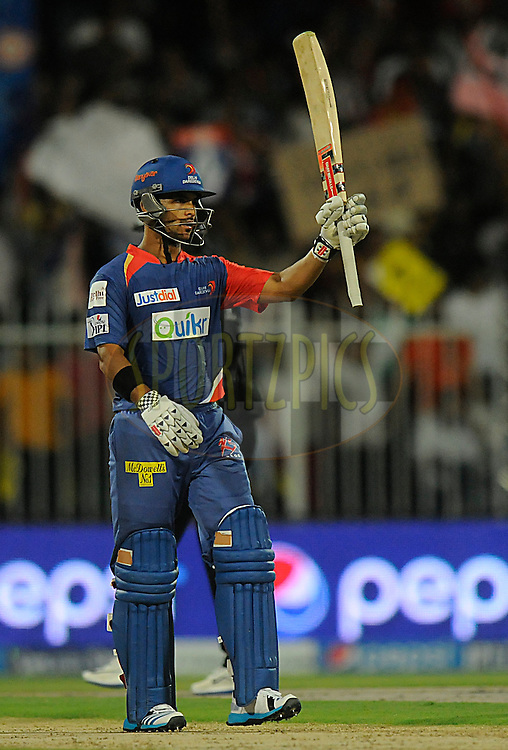 Jean-Paul Duminy of the Delhi Daredevils acknowledges teammates after scoring a half century during match 2 of the Pepsi Indian Premier League Season 7 between the Delhi Daredevils and The Royal Challengers Bangalore held at the Sharjah Cricket Stadium, Sharjah, United Arab Emirates on the 17th April 2014<br /> <br /> Photo by Pal Pillai / IPL / SPORTZPICS