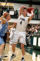 20 February 2016:  Tucker Harlan challenges ball handler Andy Stempel(4) during an NCAA men's division 3 CCIW basketball game between the Elmhurst Bluejays and the Illinois Wesleyan Titans in Shirk Center, Bloomington IL