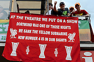 Liverpool fans display a banner as they enjoy the atmosphere in a city square in Basel pictured ahead of the UEFA Europa League Final at St. Jakob-Park, Basel<br /> Picture by Kristian Kane/Focus Images Ltd 07814482222<br /> 18/05/2016