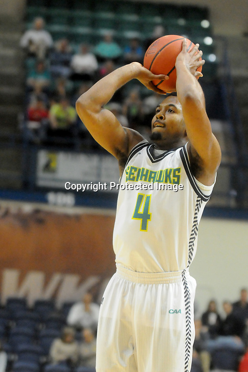 UNCW's Jordon Talley shoots against St. Andrews Wednesday December 3, 2014 at Trask Coliseum in Wilmington, N.C. (Jason A. Frizzelle)