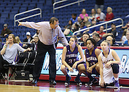 Weimar Lady Cats head coach Roger Maupin talks to Weimar Lady Cats senior forward Allison Williams (31) and Weimar Lady Cats junior center Jade Garza (41) during the UIL Class 2A girls basketball state championship game between Panhandle and Weimar High School at the Alamodome in San Antonio on Saturday, March 5, 2016.