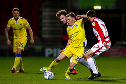 Gavin Reilly of Bristol Rovers takes on Ali Crawford of Doncaster Rovers - Mandatory by-line: Robbie Stephenson/JMP - 26/03/2019 - FOOTBALL - Keepmoat Stadium - Doncaster, England - Doncaster Rovers v Bristol Rovers - Sky Bet League One