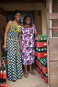 Njideka Harry (left), director of Youth for Technology, pictured with Ojiugi Ogbuji.<br /> <br /> Ojiugi started her business in 2000, beginning with door to door sales of baby items. <br /> <br /> She later expanded into the unit next door and started selling soft drinks and water too. <br /> <br /> She attended the Youth for Technology business training first and then heard about the business advice SMS service. <br /> <br /> The main thing she learnt from the training was about the importance of eye-catching displays to attract people into the shop and also the value of loans.