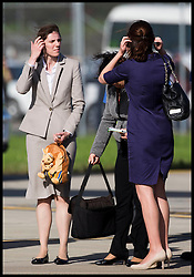 Kate's private secretary Rebecca Deacon (right) and George's nanny Maria Teresa Turrion Borrallo arrive is Sydney as The Duke and Duchess of Cambridge arrive at Sydney airport, Australia, with Prince George on day 10 of their Royal Tour of New Zealand and Australia, Wednesday, 16th April 2014. Picture by  i-Images