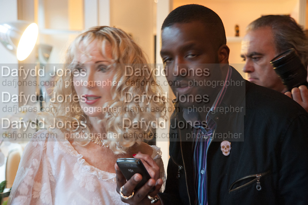 BASIA BRIGGS; ORLANDO HAMILTON, Party given by Basia Briggs and Richard Briggs at their home in Chelsea. London. 14 May 2012