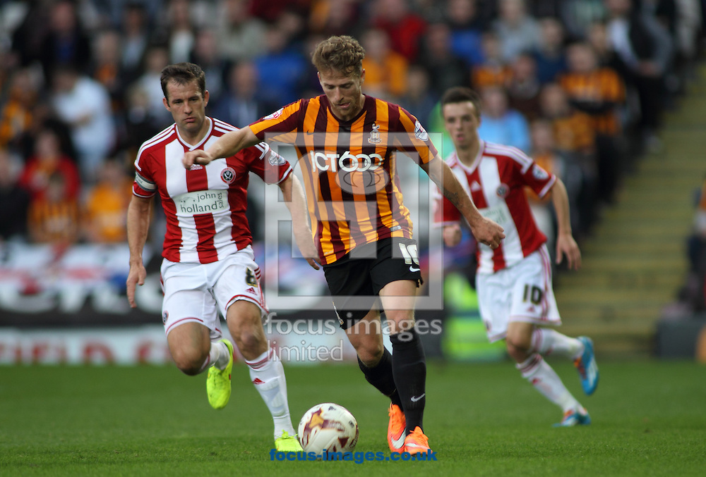 Billy Clarke (C) of Bradford City on the attack against Sheffield United during the Sky Bet League 1 match at the Coral Windows Stadium, Bradford<br /> Picture by Stephen Gaunt/Focus Images Ltd +447904 833202<br /> 18/10/2014