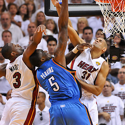 Jun 17, 2012; Miam, FL, USA; Oklahoma City Thunder center Kendrick Perkins (5) shoots over Miami Heat shooting guard Dwyane Wade (3) and small forward Shane Battier (31) during the fourth quarter in game three in the 2012 NBA Finals at the American Airlines Arena. Miami won 91-85. Mandatory Credit: Derick E. Hingle-US PRESSWIRE