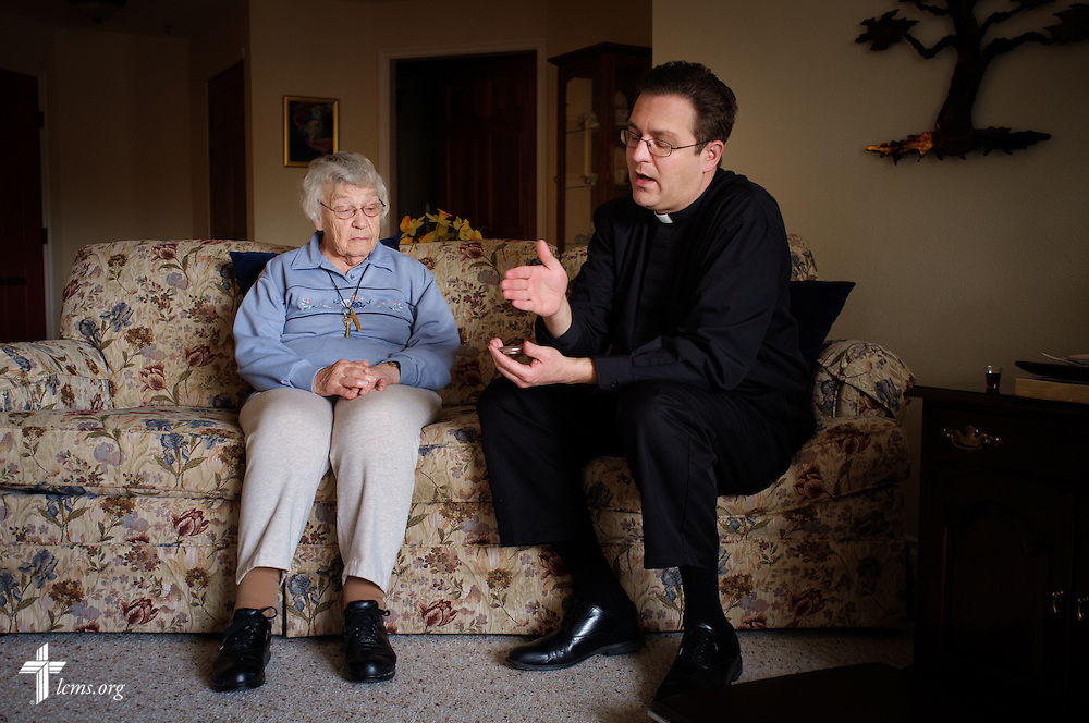 The Rev. Mark Nierman, pastor of Mount Olive Lutheran Church, consecrates the elements for communion as he visits homebound shut-in member Bernice Schumacher on Thursday, March 3, 2016, in Loveland, Colo. LCMS Communications/Erik M. Lunsford