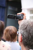 Tourist videoing buskers on Grafton Street Dublin Ireland