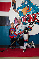 KELOWNA, CANADA - FEBRUARY 10: Kole Lind #16 of the Kelowna Rockets poses with a young fan against the Vancouver Giants on February 10, 2017 at Prospera Place in Kelowna, British Columbia, Canada.  (Photo by Marissa Baecker/Shoot the Breeze)  *** Local Caption ***