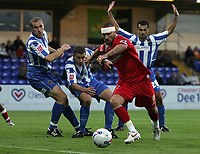 Photo: Paul Thomas.<br /> Chester City v Swindon Town. Coca Cola League 2. 01/09/2006.<br /> <br /> Christian Roberts (Red) gets past the Chester defence to put a shot at goal.
