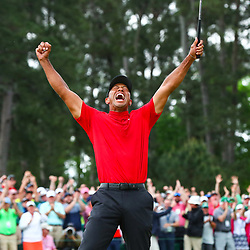 Apr 14, 2019; Augusta, GA, USA; Tiger Woods celebrates after making a putt on the 18th green to win The Masters golf tournament at Augusta National Golf Club. Photo : Rob Schumacher / SUSA / Icon Sport