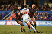 Sitaleki Akauola (18) of Warrington Wolves tackles Joe Arundel (20) of Wakefield Trinity during the Betfred Super League match between Wakefield Trinity Wildcats and Warrington Wolves at Belle Vue, Wakefield, United Kingdom on 16 February 2020.