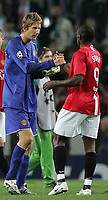 Photo: Paul Thomas.<br /> Sporting Lisbon v Manchester United. UEFA Champions League Group F. 19/09/2007.<br /> <br /> Man Utd keeper and hero,Edwin van der Sar, is congratulated by team-mate Louis Saha after the game.