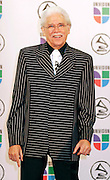 Johnny Pacheco poses in the press room at the 7th Annual Latin Grammy Awards at Madison Square Garden  on Thursday, November 2, 2006 in New York.