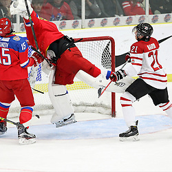 COBOURG, - Dec 19, 2015 -  Gold Metal Game - Russia vs Canada West at the 2015 World Junior A Challenge at the Cobourg Community Centre, ON. Goaltender Mikhail Berdin #1 of Team Russia makes the save going airborne during the first period.(Photo: Tim Bates / OJHL Images)
