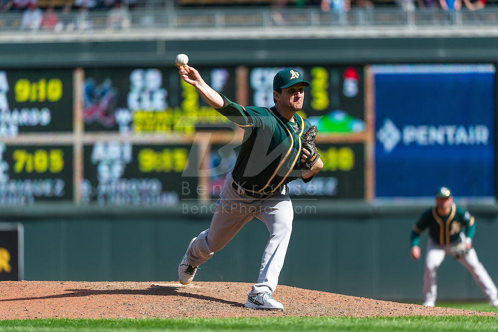 Dan Otero #61 of the Oakland Athletics pitches against the Minnesota Twins on April 9, 2014 at Target Field in Minneapolis, Minnesota.  The Athletics defeated the Twins 7 to 4.  Photo by Ben Krause