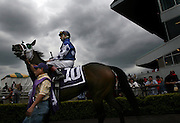 Jockey Ricky Frazier rides his horse Judicature around the paddock area at Emerald Downs before entering the racing track and competing in the stakes race May 12. ....