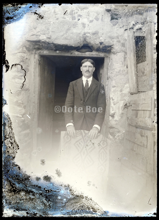 eroding glass plate photo with an adult man