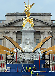 © Licensed to London News Pictures. 06/06/2012. London, UK. Workmen deconstruct the stage in front of Buckingham Palace. Workmen begin the task of deconstructing the stages and scaffolding platforms put in place for the celebrations.  The Royal Jubilee celebrations. Great Britain is celebrating the 60th  anniversary of the countries Monarch HRH Queen Elizabeth II accession to the throne this weekend Photo credit : Stephen Simpson/LNP