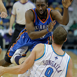 Oct 10, 2009; New Orleans, LA, USA; Oklahoma City Thunder guard James Harden (13) is hit in the groin by New Orleans Hornets center Darius Songaila (9) as he passes the ball during the second half at the New Orleans Arena. The Hornets defeated the Thunder 88-79. Mandatory Credit: Derick E. Hingle-US PRESSWIRE