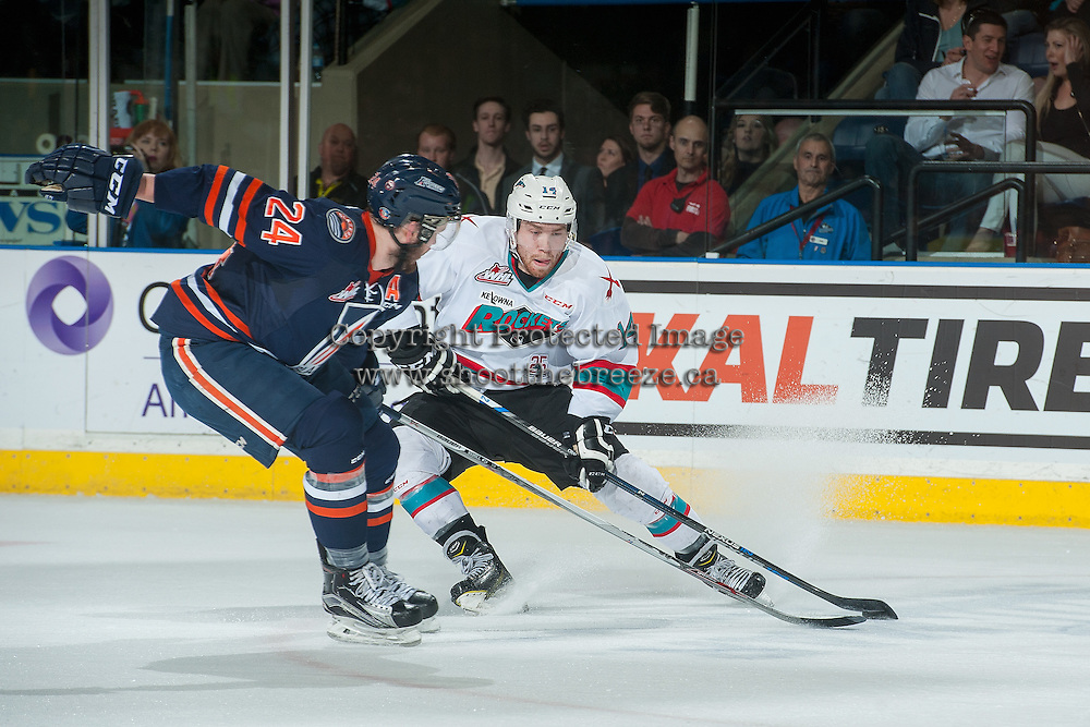 KELOWNA, CANADA - APRIL 1: Ryan Rehill #24 of Kamloops Blazers checks Rourke Chartier #14 of Kelowna Rockets as he stops with the puck during first period on April 1, 2016 at Prospera Place in Kelowna, British Columbia, Canada.  (Photo by Marissa Baecker/Shoot the Breeze)  *** Local Caption *** Ryan Rehill; Rourke Chartier;