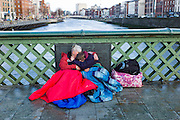 The day after Valentine's night, cuddling up on GRATTAN BRIDGE over the River LIFFEY in DUBLIN
