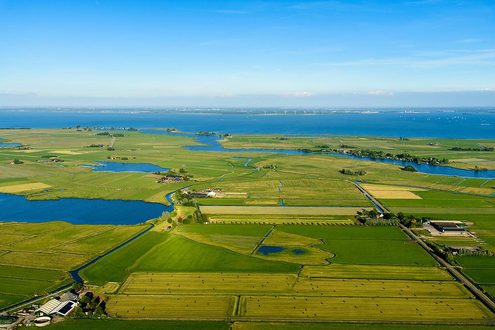 Nederland, Noord-Holland, Waterland, 13-06-2017; overzicht Waterland, met in het verschiet Uitdam, Uitdammer Die, Holysloter Die, Holysloot (rechts). Belmermeer in de voorgrond, IJsselmeer richting Almere aan de horizon.<br /> Waterland, rural area north of Amsterdam.<br /> luchtfoto (toeslag op standard tarieven);<br /> aerial photo (additional fee required);<br /> copyright foto/photo Siebe Swart