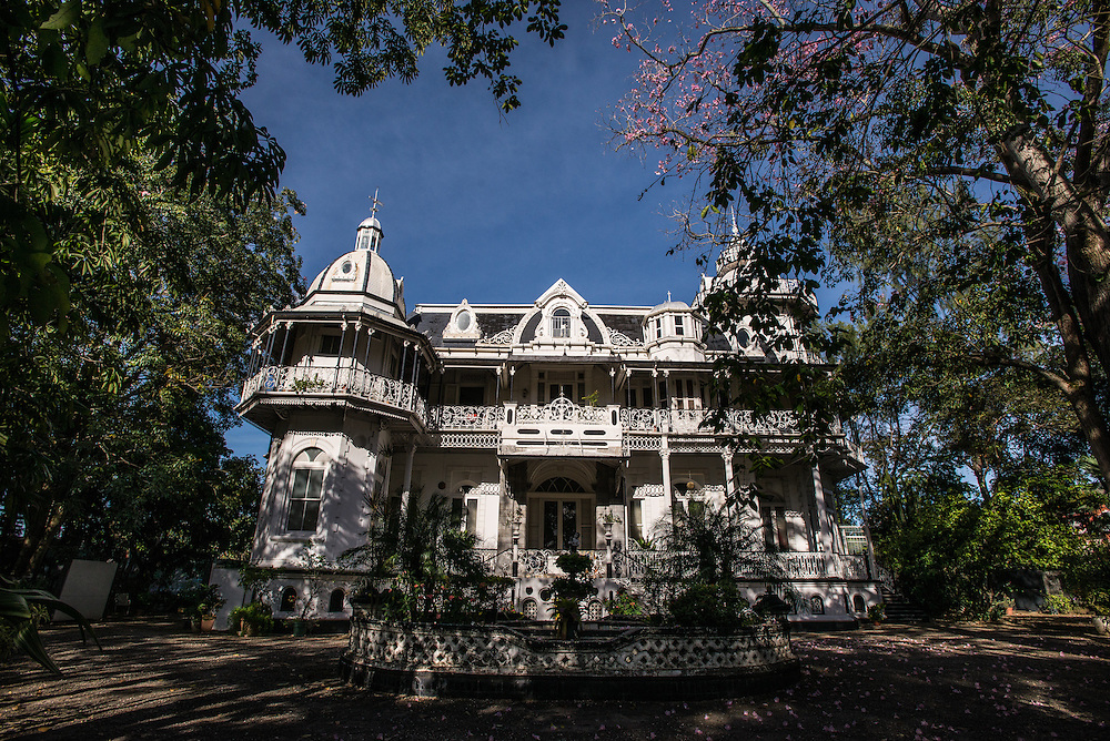 PORT OF SPAIN, TRINIDAD - FEBRUARY 15, 2017: One of the &quot;Magnificent Seven&rdquo;, a series of architecturally varied mansions that line the west side of the Savannah; these exist in various states of disrepair yet retain their early 20th-century grandeur.<br />