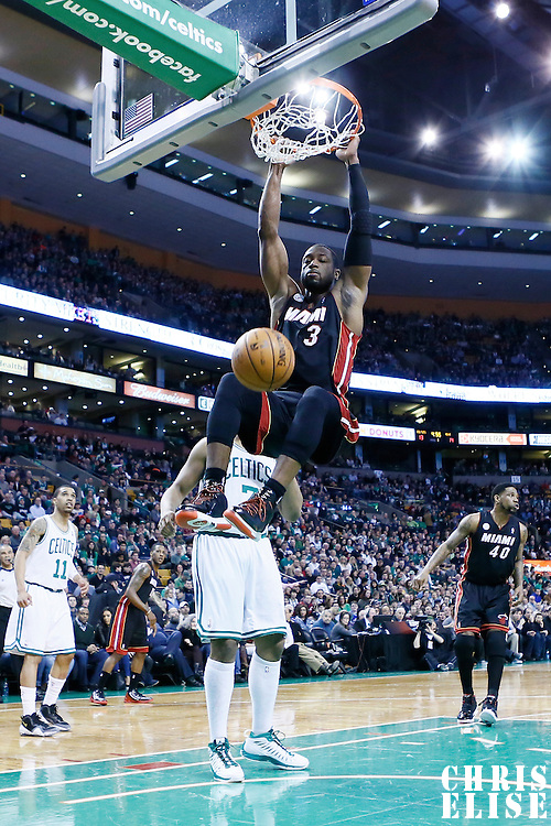 27 January 2013: Miami Heat shooting guard Dwyane Wade (3) dunks the ball during the Boston Celtics 100-98  2OT victory over the Miami Heat at the TD Garden, Boston, Massachusetts, USA.