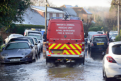 © Licensed to London News Pictures. 12/01/2014. Wraysbury, UK.A water and animal rescue vehicle makes its way along a flooded road. Flooding in Wraysbury, Berkshire today 12th January 2014.  Flooding and property damage is expected to continue along the River Thames.  Large areas of Britain are experiencing flooding after wet weather. Photo credit : Stephen Simpson/LNP