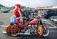 Matt Johnson of Langhorne, puts on his helmet while dressed as Santa for the ride on his Indian Motorcycle along with other members of the Delaware Valley Iron Indian Riders Association who held their annual Ride Of the Santas and dropped off toys to children at  Saturday, December 21, 2019 at St Francis-St Vincent Home For Children in Bensalem, Pennsylvania. (Photo by William Thomas Cain / CAIN IMAGES)