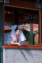 CHINA BEIJING APR99 - A Chinese bride looks out of a window prior to their wedding photo at Beihai Park. ..jre/Photo by Jiri Rezac..© Jiri Rezac 1999..Contact: +44 (0) 7050 110 417.Mobile:  +44 (0) 7801 337 683.Office:  +44 (0) 20 8968 9635..Email:   jiri@jirirezac.com.Web:    www.jirirezac.com..© All images Jiri Rezac 1999 - All rights reserved.