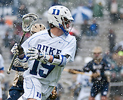 Duke attack Christian Walsh #19 dodges up field. The third-ranked Fighting Irish defeated sixth-ranked Duke, 13-5, in men's lacrosse action on a snowy Saturday afternoon at Koskinen Stadium in Durham, N.C.