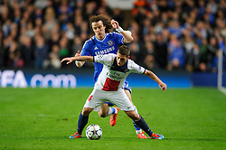 PSG Midfielder Marco Verratti (ITA) is challenged by Chelsea Midfielder Willian (BRA) - Photo mandatory by-line: Rogan Thomson/JMP - 07966 386802 - 08/04/2014 - SPORT - FOOTBALL - Stamford Bridge, London - Chelsea v Paris Saint-Germain - UEFA Champions League Quarter-Final Second Leg.