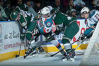 KELOWNA, CANADA - JANUARY 22: Rourke Chartier #14 of the Kelowna Rockets checks Ben Betker #5 of the Everett Silvertips into the boards on January 22, 2014 at Prospera Place in Kelowna, British Columbia, Canada.   (Photo by Marissa Baecker/Getty Images)  *** Local Caption *** Rourke Chartier; Ben Betker;