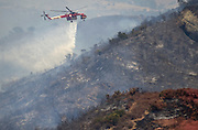 July 13, 2015 - Yorba Linda, CA, USA - <br /> <br /> water planes take to the sky to help put out fires<br /> <br /> A helicopter drops water on vegetation along the 241 toll road on the Irvine / Orange border Monday. More than 150 acres burned and threatened some structures near Irvine Lake causing officials to close down Santiago Canyon Road in unincorporated Orange County, California<br /> ©Exclusivepix Media