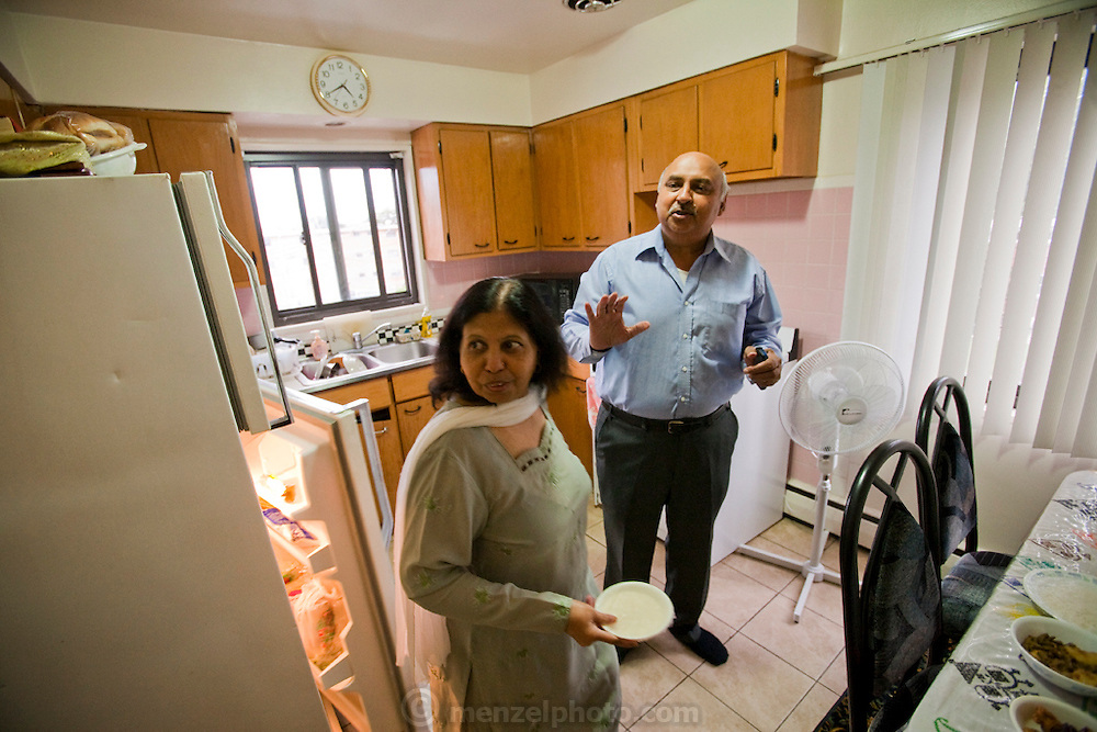 Din Memon, a Chicago taxi driver at his home with his wife in Chicago, Illinois. (Din Memon is featured in the book What I Eat: Around the World in 80 Diets.)