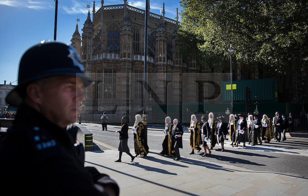 © Licensed to London News Pictures. 03/10/2016. London, UK. A policeman looks on as judges walk to Parliament after attending a Service at Westminster Abbey. The Service heralds the start of the legal year in the United Kingdom  - the fourth term of the legal year, known as Michaelmas term. Photo credit: Peter Macdiarmid/LNP