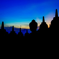 The stupas of Borobudur Temple silhouetted before an amazing sunrise, Magelang, Indonesia, 2016