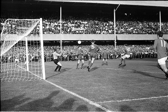 Waterford FC vs Manchester United at Lansdowne Road..1968..18.09.1968..09.18.1968..18th September 1968..Waterford FC as champions of the league of Ireland drew Manchester United, the European Champions,in the first round of this years competition.The Waterford team was as follows: Peter Thomas, Peter Bryan, Noel Griffin, Vinny Maguire, Jackie Morley, Jimmy McGeough, Al Casey, Alfie Hale, John O'Neill, Shamie Coad and Johnny Matthews. Manchester United won the tie 3 -1 with Denis Law being the man of the match..Alex Stepney,Tony Dunne,Francis Burns,Paddy Crerand,.Bill Foulkes,Nobby Stiles,George Best,Denis Law,.Bobby Charlton,David Sadler,Brian Kidd were the starting eleven for United....Image shows a Denis Law strike but he could only volley the ball over the bar.