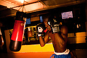 SYRACUSE, NY – NOVEMBER 17, 2010: A young athlete trains at the North Area Athletic Athletic and Education Center. The N.A.A.C. exists to provide opportunities for youth to get involve themselves in productive activities instead of drugs and violence. During the thirty-day program, youth are trained in the discipline of boxing.