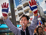 29 NOVEMBER 2013 - BANGKOK, THAILAND: Office workers in Bangkok cheer anti-government protestors. Although the government has a popular mandate, most of its supporters are from the rural northeast part of Thailand. Most members of Bangkok's middle class oppose the government. Several thousand Thai anti-government protestors marched on the US Embassy in Bangkok. They blew whistles and asked the US to honor their efforts to unseat the elected government of Yingluck Shinawatra. The anti-government protestors marched through several parts of Bangkok Friday paralyzing traffic but no clashes were reported, even after a group protestors tried to occupy Army headquarters.       PHOTO BY JACK KURTZ