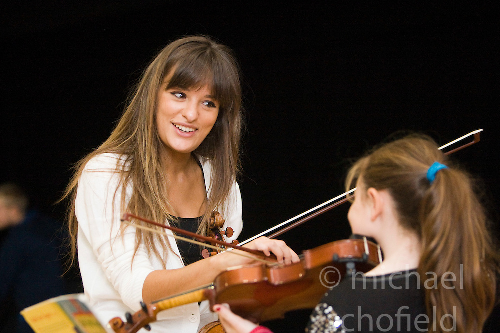 Scottish violinist Nicola Benedetti gave a series of musical masterclasses to the children of Raploch's Big Noise orchestra today. Pic with Tamika Ketterick (9)..Pic ©2010 Michael Schofield. All Rights Reserved.