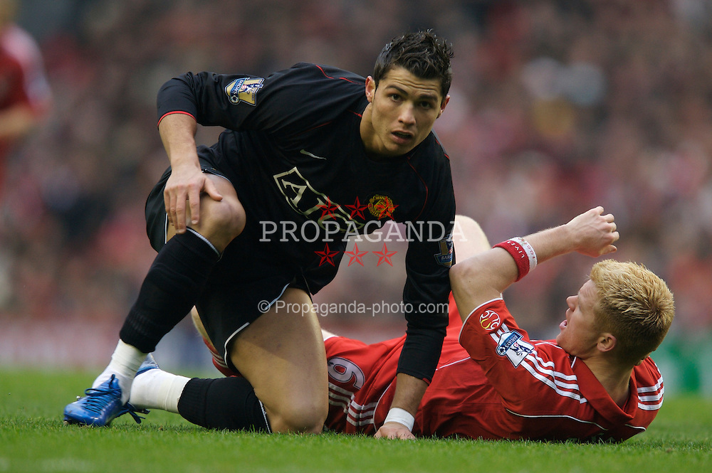 LIVERPOOL, ENGLAND - Sunday, December 16, 2007: Liverpool's John Arne Riise brought down by Manchester United's Cristiano Ronaldo  during the Premiership match at Anfield. (Photo by David Rawcliffe/Propaganda)