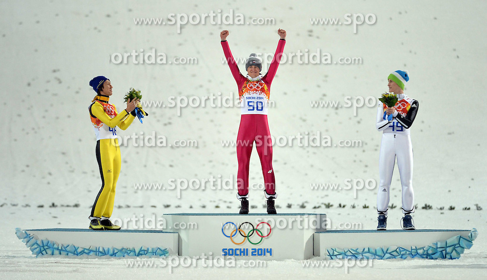 15.02.2014, RusSki Gorki Jumping Center, Krasnaya Polyana, RUS, Sochi, 2014, Skisprung, Herren Grossschanze, im Bild Gold medalist Kamil Stoch of Poland, flanked by silver medalist Noriaki Kasai (L) and bronze medalist Peter Prevc (R) // Gold medalist Kamil Stoch of Poland, flanked by silver medalist Noriaki Kasai (L) and bronze medalist Peter Prevc (R) during Mens Large Hill Ski Jumping of the Olympic Winter Games Sochi 2014 at the RusSki Gorki Jumping Center in Krasnaya Polyana, Russia on 2014/02/15. EXPA Pictures &copy; 2014, PhotoCredit: EXPA/ Newspix/ TOMASZ JAGODZINSKI<br /> <br /> *****ATTENTION - for AUT, SLO, CRO, SRB, BIH, MAZ, TUR, SUI, SWE only*****
