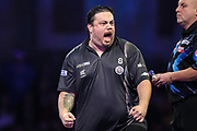 Danny Baggish hits a double and wins the fourth set during the PDC William Hill World Darts Championship at Alexandra Palace, London, United Kingdom on 15 December 2019.