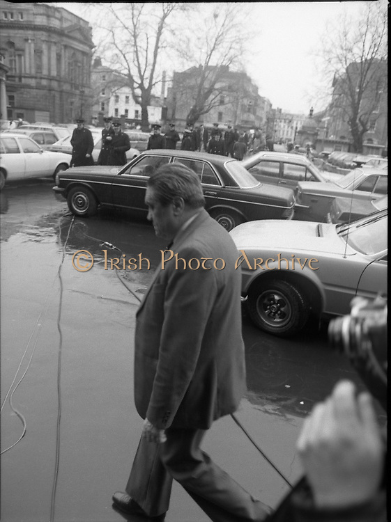TDs arrive for the opening session of the 23rd Dáil...9-03-82.03-09-1982.9th March 1982..Pictured At Leinster House. ..USSR's Ambasssador arriving ariving in rain.