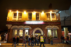 LIVERPOOL, ENGLAND - Wednesday, December 15, 2010: Fans walk pas the Albert Pub next to Anfield Stadium, a popular drinking establishment for Kopites, before the UEFA Europa League Group K match between Liverpool and FC Utrecht at Anfield. (Photo by: David Rawcliffe/Propaganda)