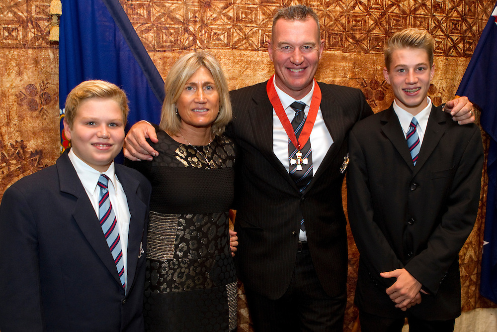Sir John Kirwan with his family, wife Fiorella and sons Luca and Niko after he received the Insignia of a Companion of the New Zealand Order of Merit from the Governor-General Lieutenant General Sir Jerry Mateparae at an Investiture Ceremony, Government House, Auckland, New Zealand, Wednesday, May 08, 2013.  Credit:SNPA / David Rowland